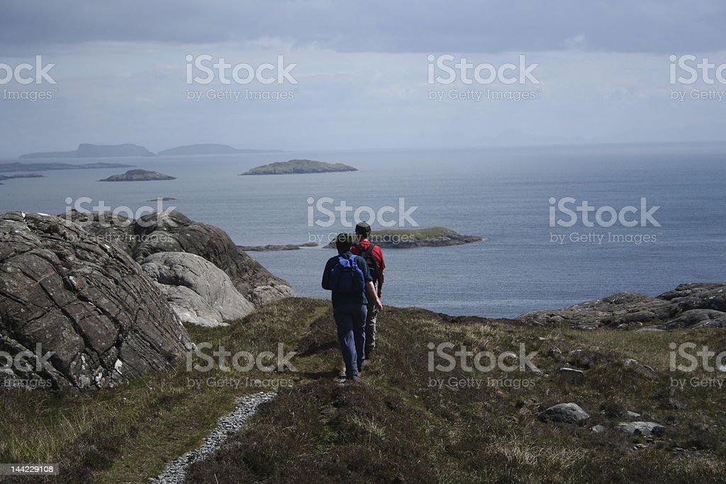 couple walking along path stock photo