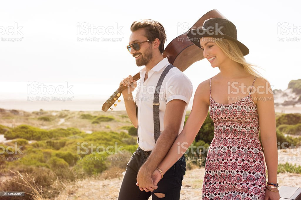 Couple walking at beach stock photo
