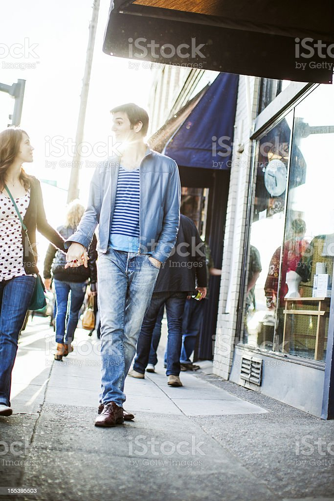 Couple Walking by Storefront royalty-free stock photo