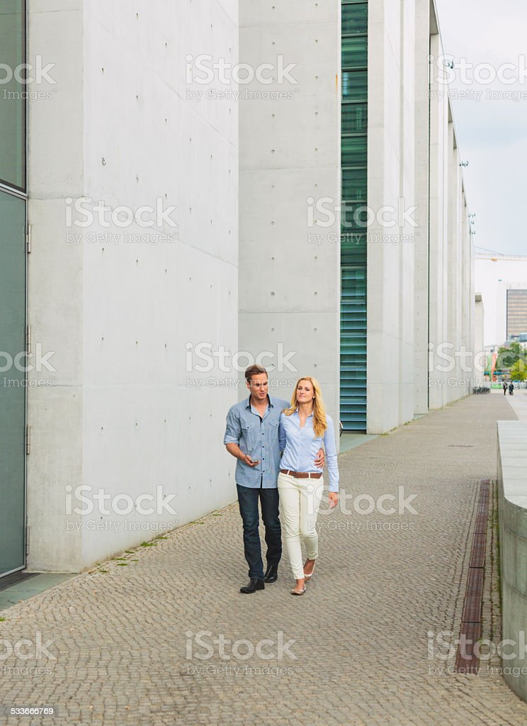 Couple walking in a city stock photo