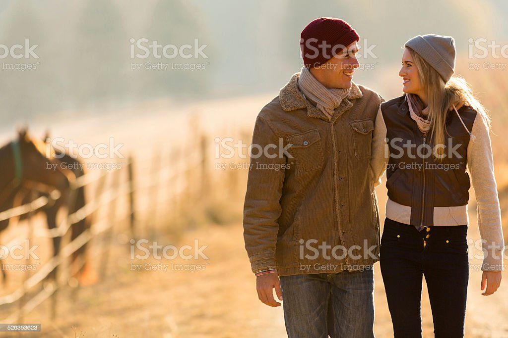 couple walking in countryside stock photo