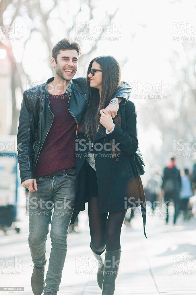 Couple walking in famous Barcelona Ramblas street. stock photo