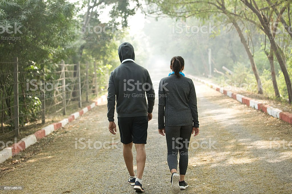 Couple walking in park stock photo