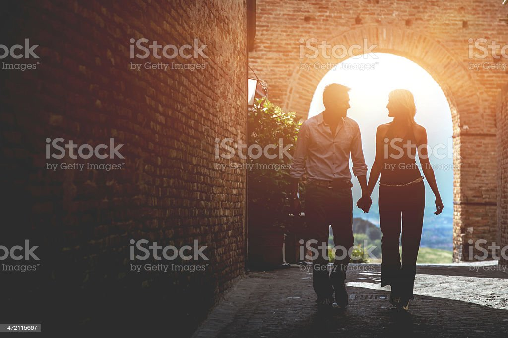 Couple walking in the old town stock photo