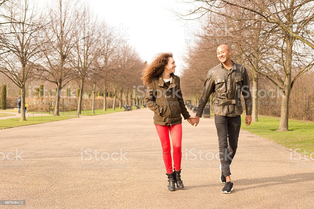 couple walking in the park royalty-free stock photo