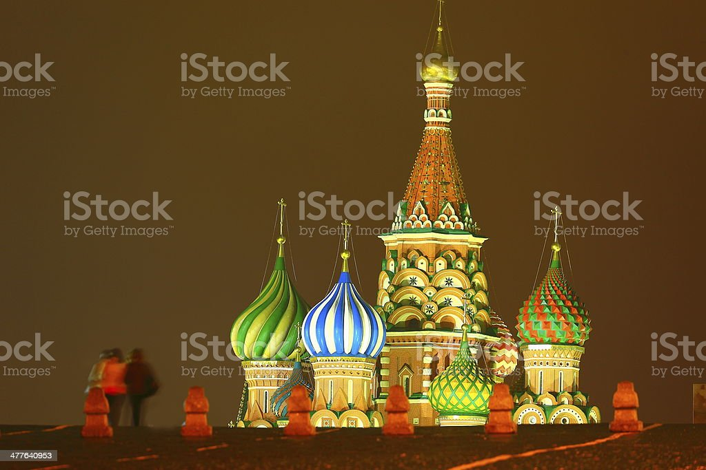 Couple walking into Red Square in Moscow at dusk, Russia royalty-free stock photo