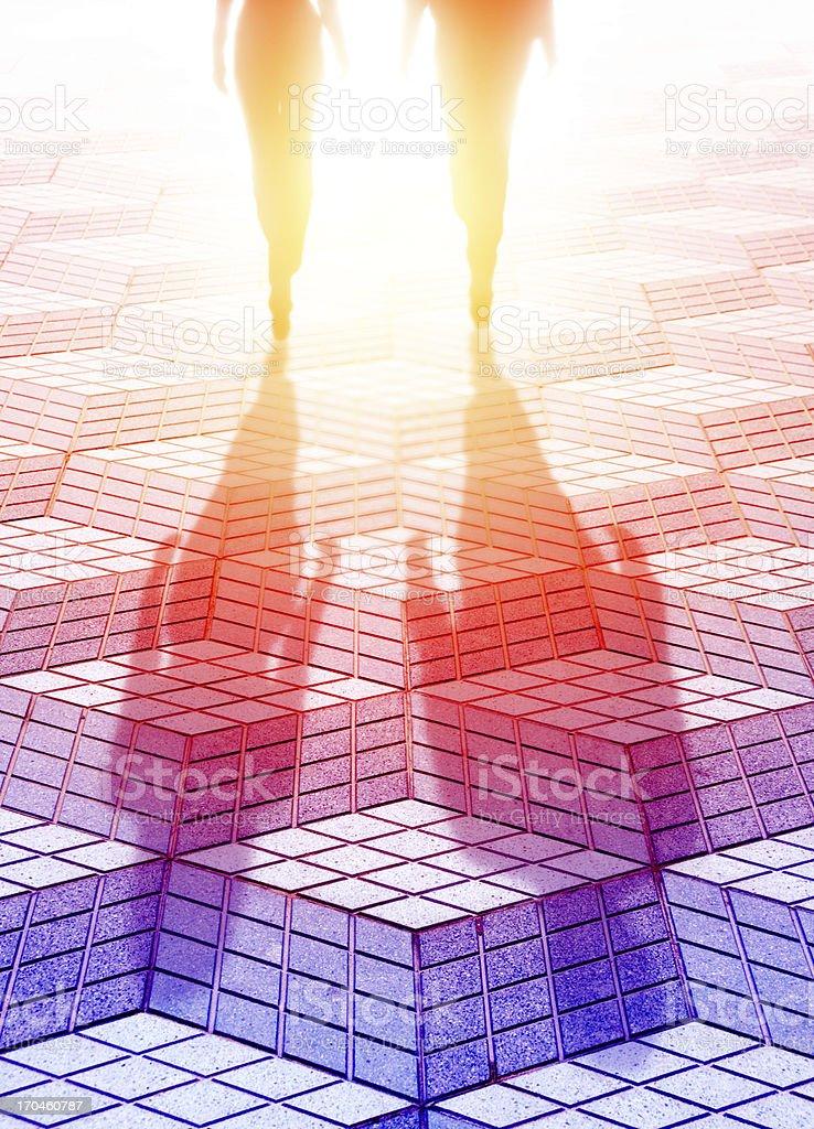 Couple walking into the bright light, future royalty-free stock photo
