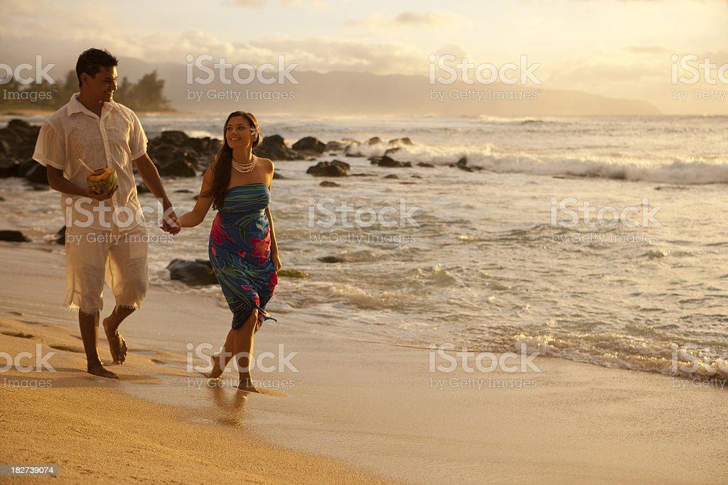 Couple Walking on Beach royalty-free stock photo