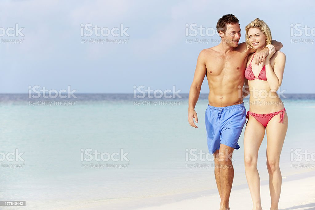 Couple Walking On Beautiful Tropical Beach stock photo