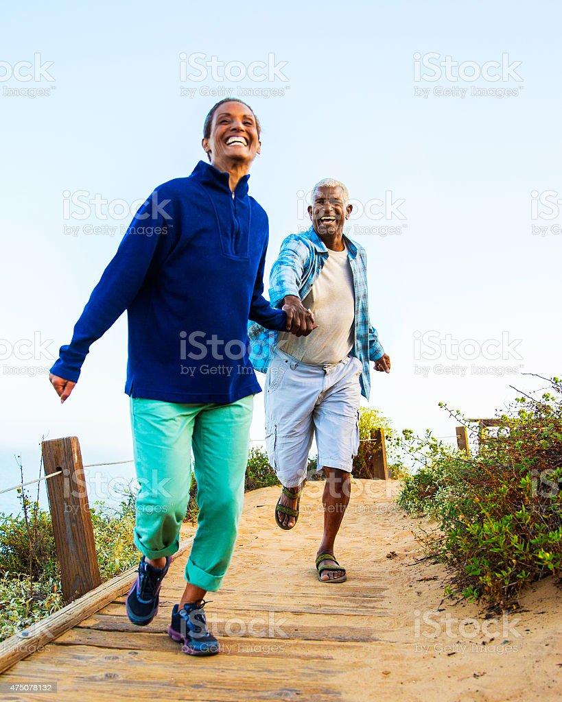 Couple walking on boardwalk. stock photo