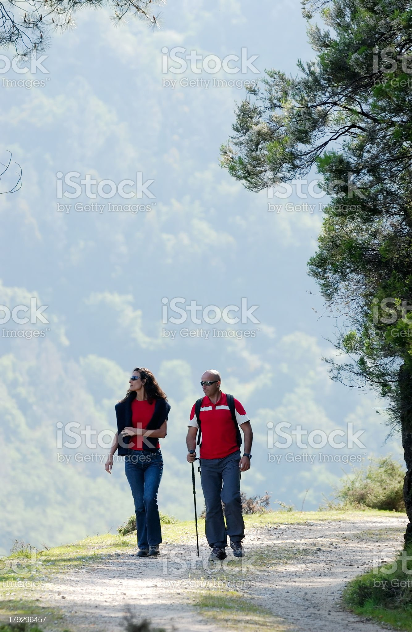 Couple walking on dirt road royalty-free stock photo