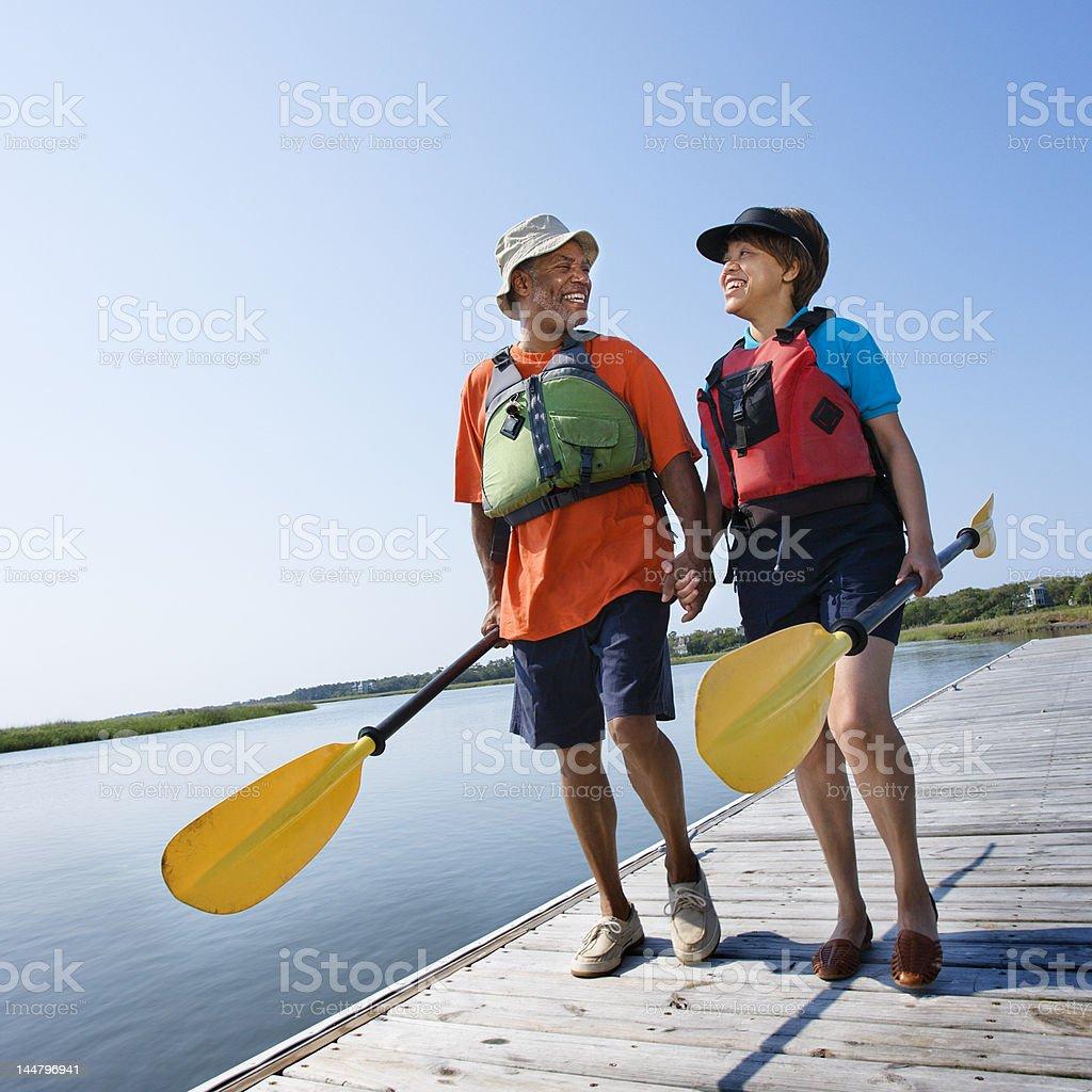 Couple walking on dock. royalty-free stock photo