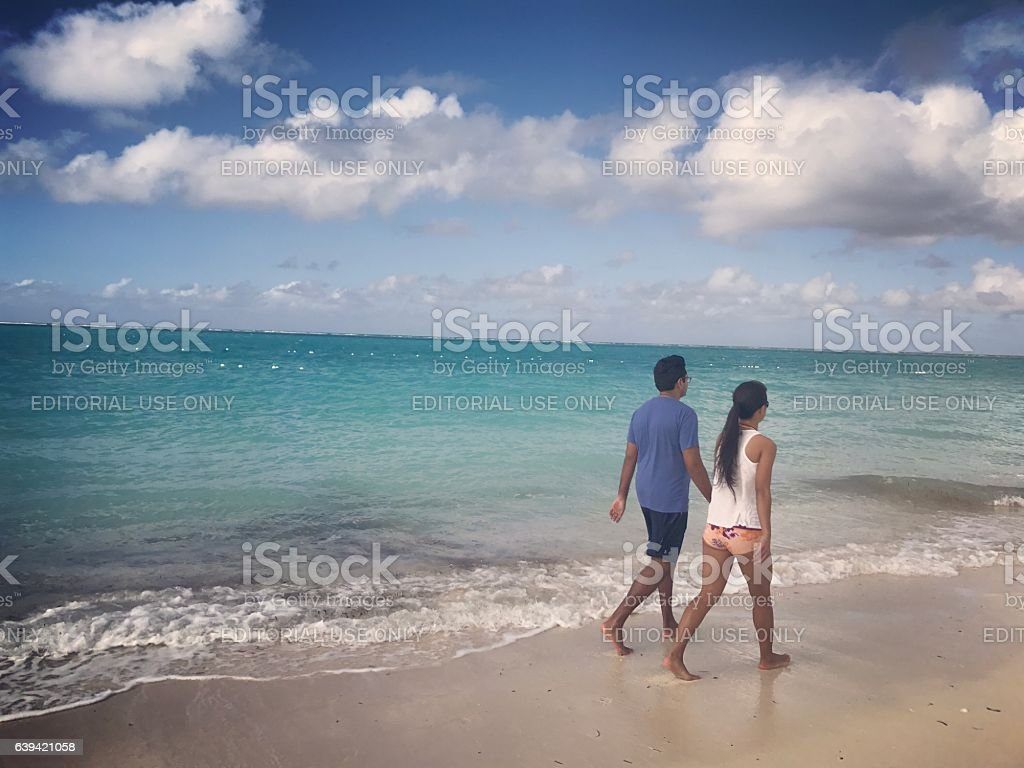 Couple walking on Grace Bay Beach, Turks and Caicos stock photo