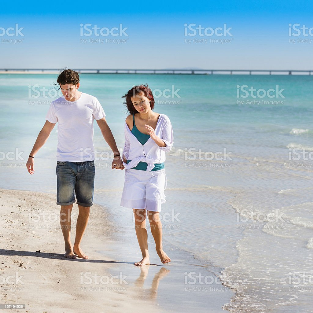 Couple walking on the beach at summer royalty-free stock photo