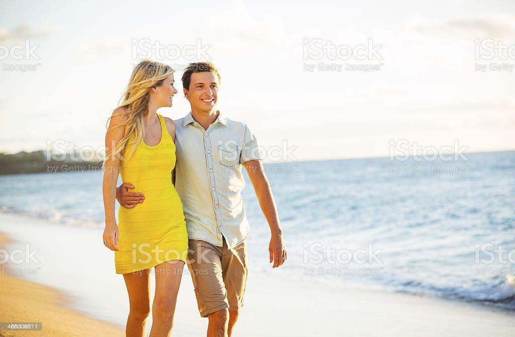 Couple Walking on the beach at Sunset, Romantic Vacation stock photo