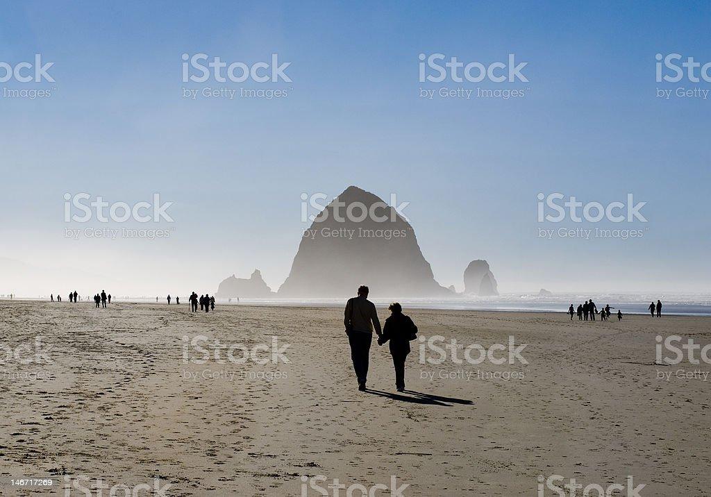 Couple walking on the Beach stock photo