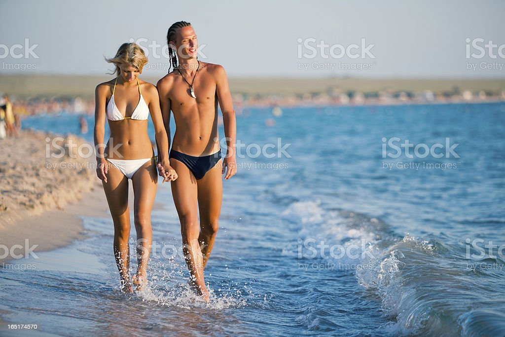 Couple walking on the beach royalty-free stock photo
