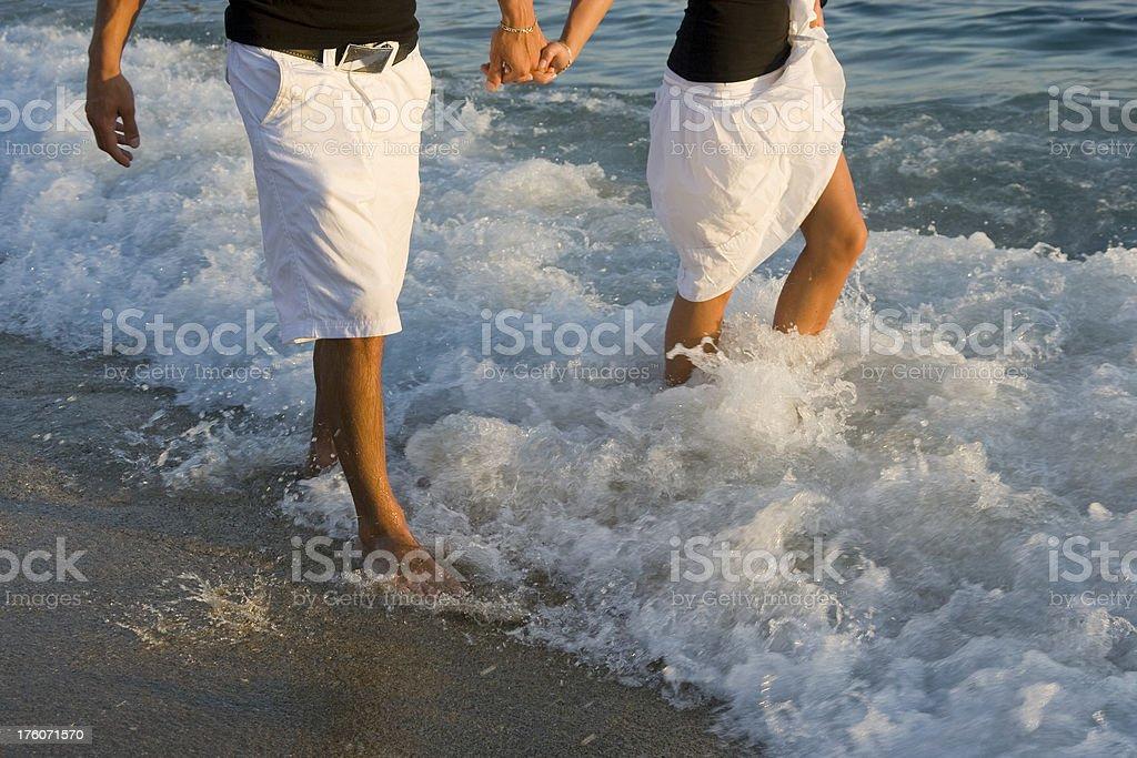 Couple walking on the beach royalty-free stock photo
