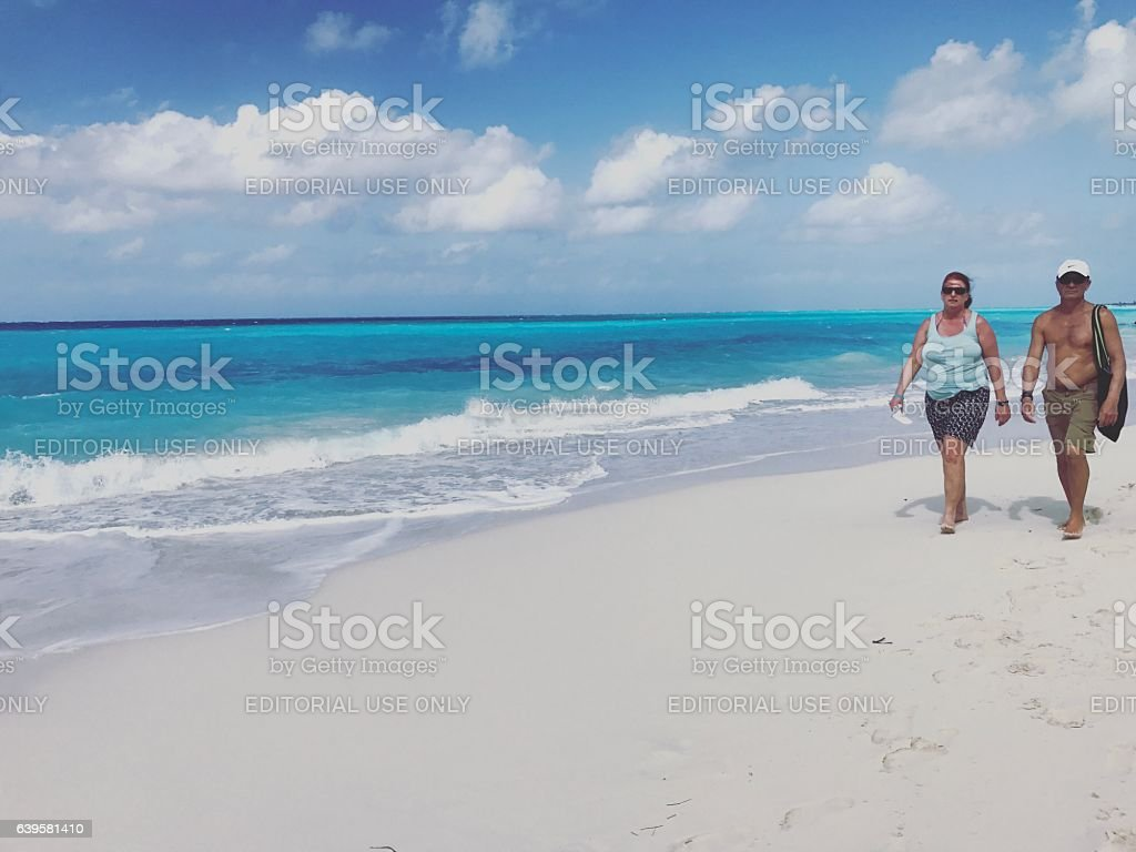 Couple walking on the beach. Turks and Caicos Islands stock photo