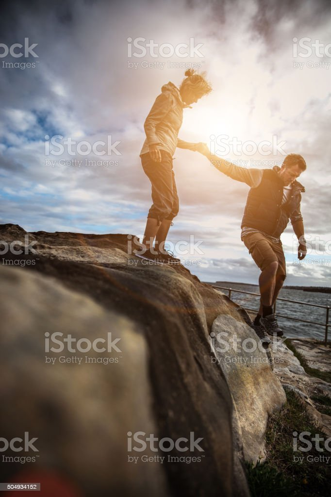 Couple walking on the cliffs around Bondi Beach - Sydney stock photo