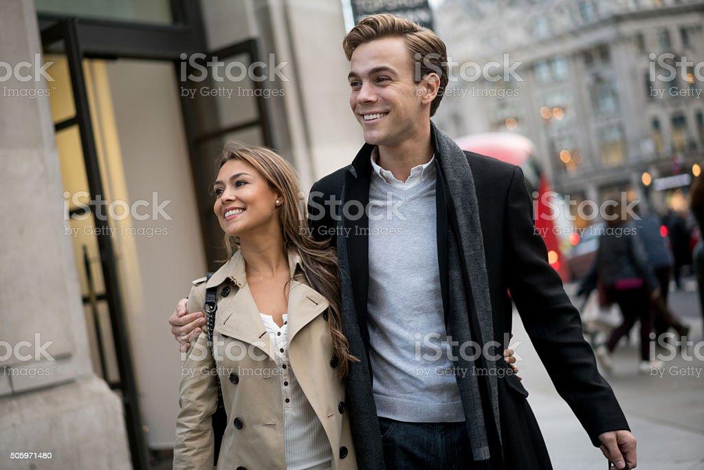 Couple walking on the street stock photo