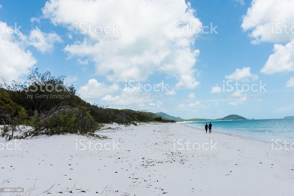 Couple walking on Whitehaven Beach, Whitsunday Island, Queensland, Australia stock photo