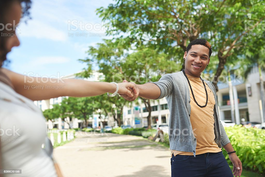 Couple walking outdoors stock photo