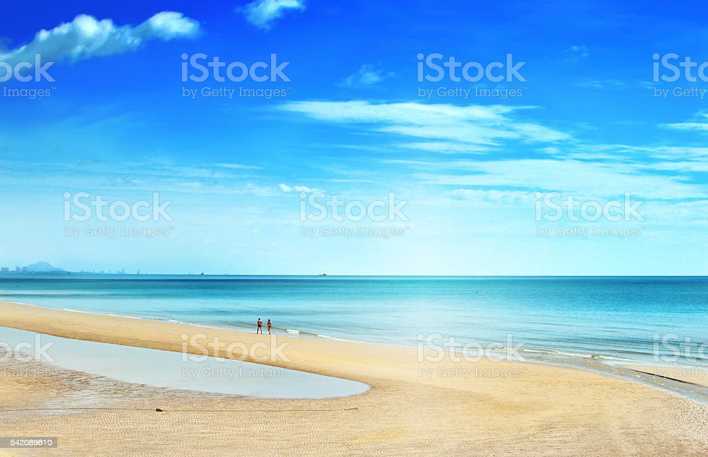 Couple walking relaxing on  beach Huahin, Thailand. stock photo