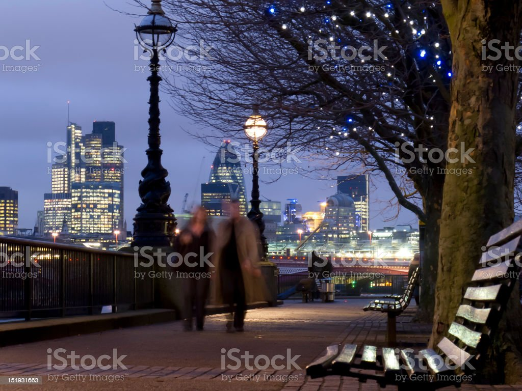 Couple walking - romantic with City of London backdrop stock photo