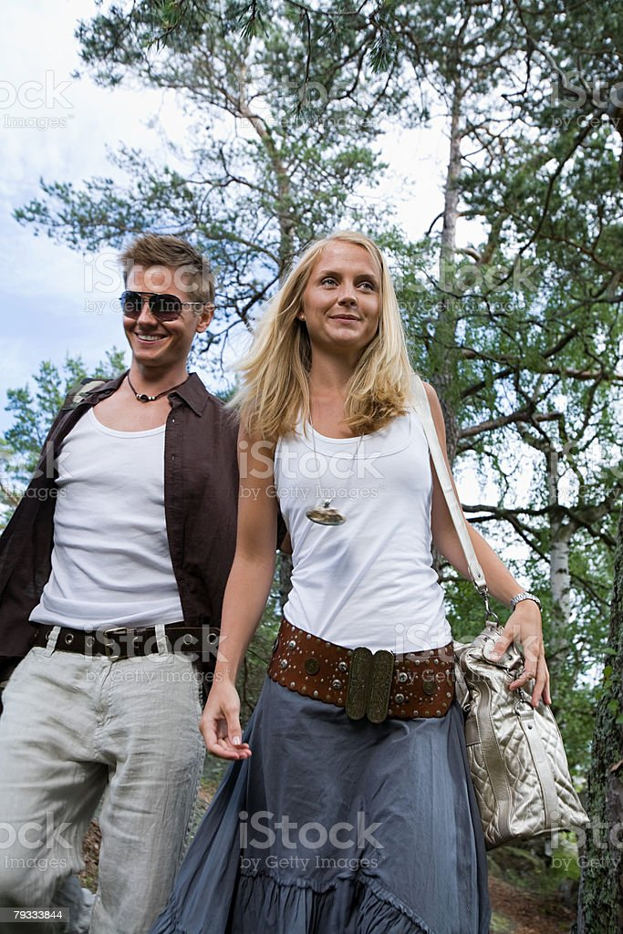 A couple walking through forest royalty-free stock photo