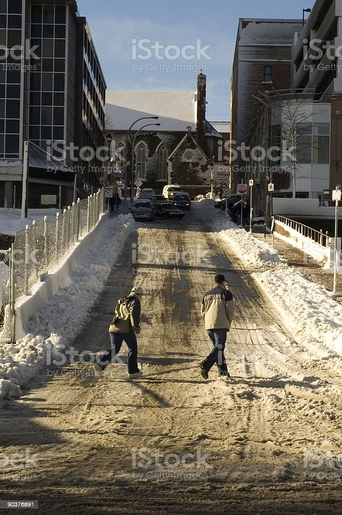 Couple walking through slush royalty-free stock photo