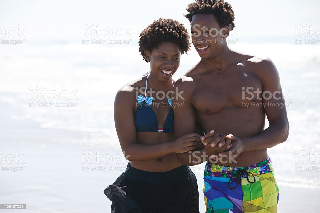 Couple walking together on beach royalty-free stock photo