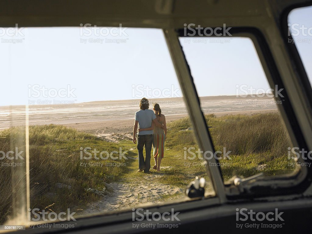 Couple Walking Towards Beach stock photo