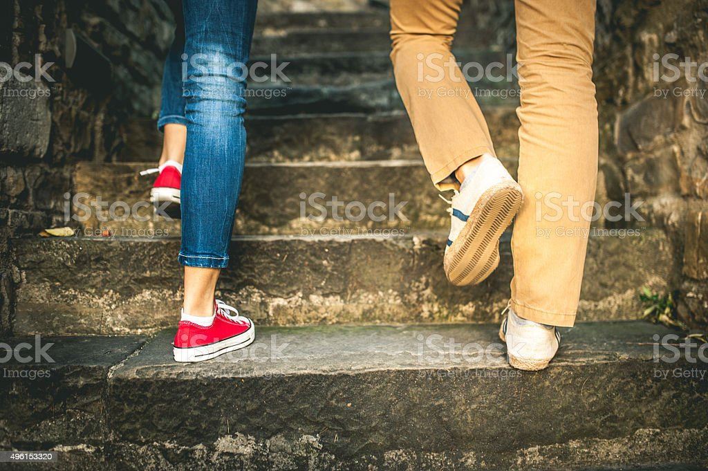 Couple Walking Up Steps stock photo