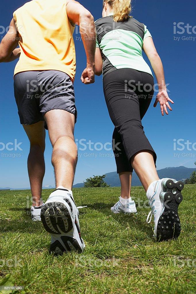 Couple walking uphill stock photo