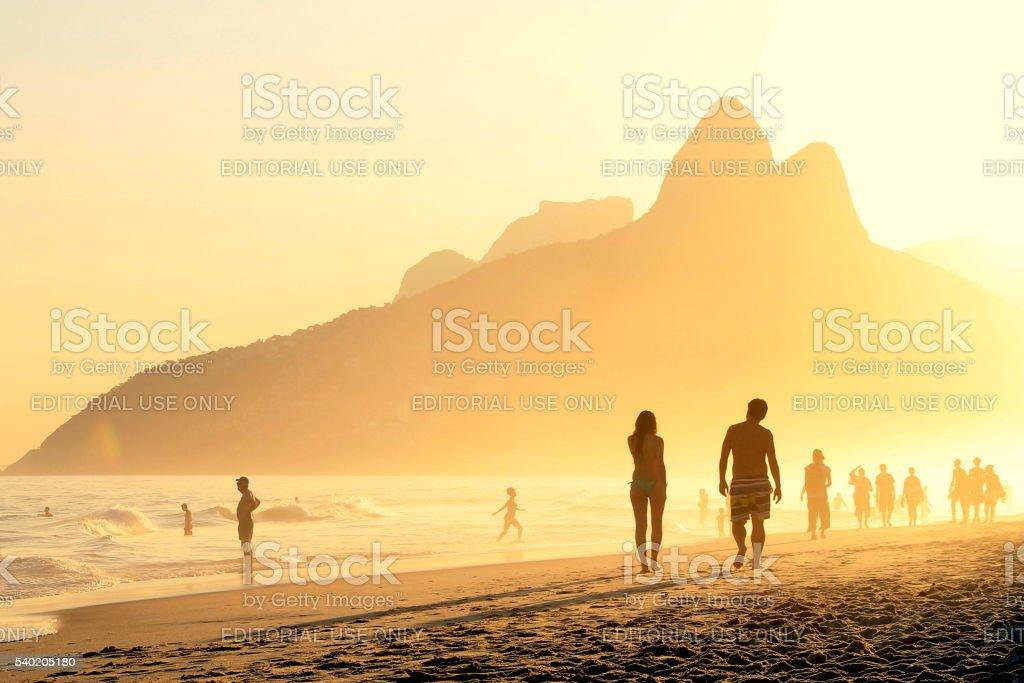 Couple walks on Ipanema´s sunset stock photo