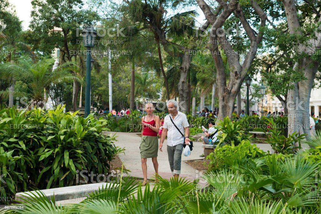Couple Walks Tropical Parque Central in Travel Destination Havana Cuba stock photo
