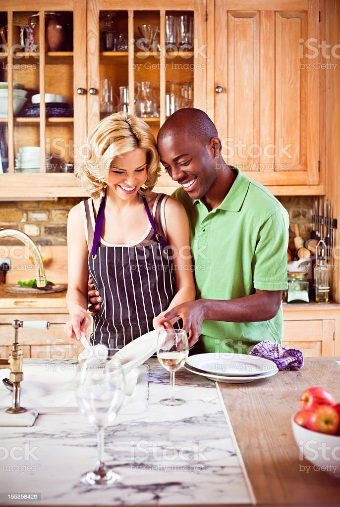 Couple washing dishes royalty-free stock photo