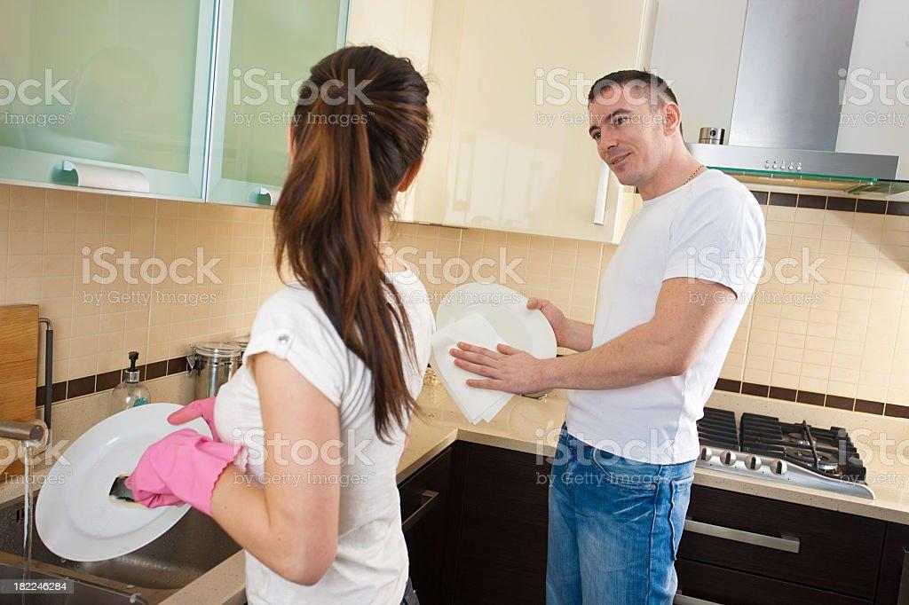 Couple washing dishes royalty-free stock photo