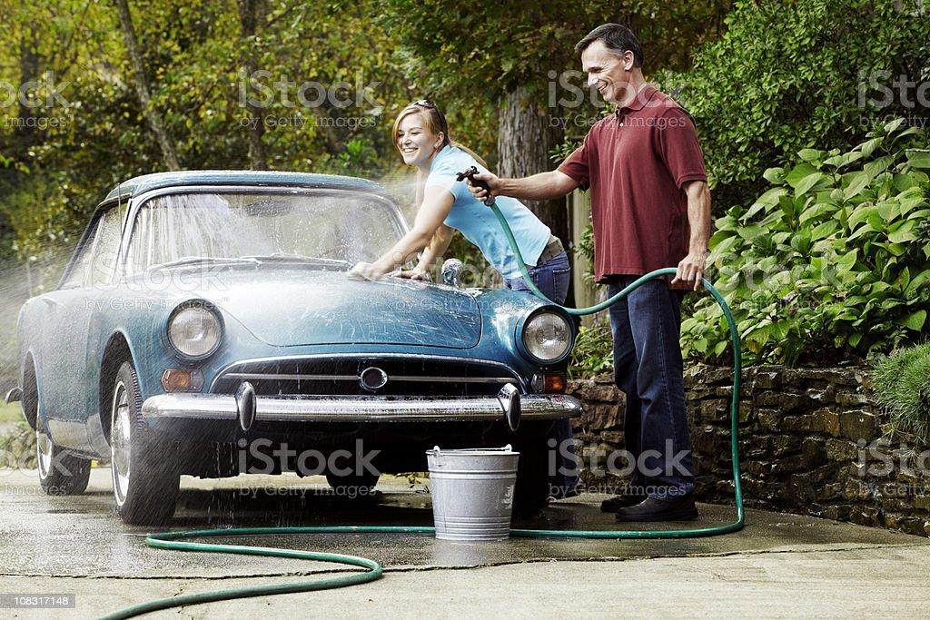Couple Washing Vintage Car stock photo