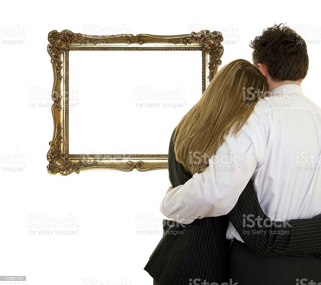 Couple watching a frame royalty-free stock photo