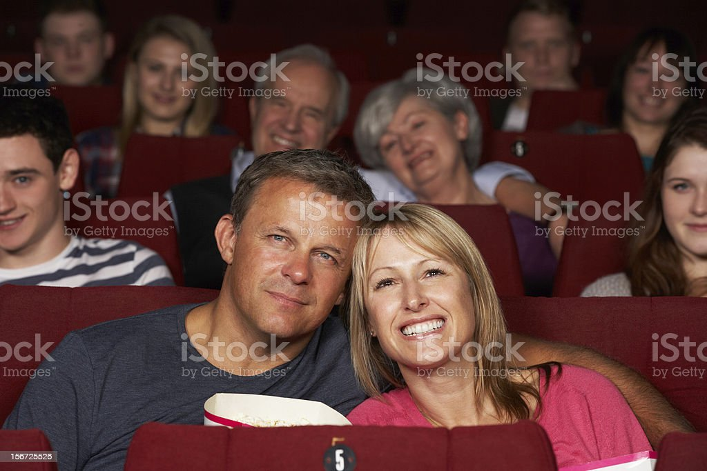 Couple Watching Film In Cinema stock photo