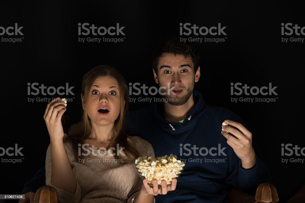 couple watching movie stock photo