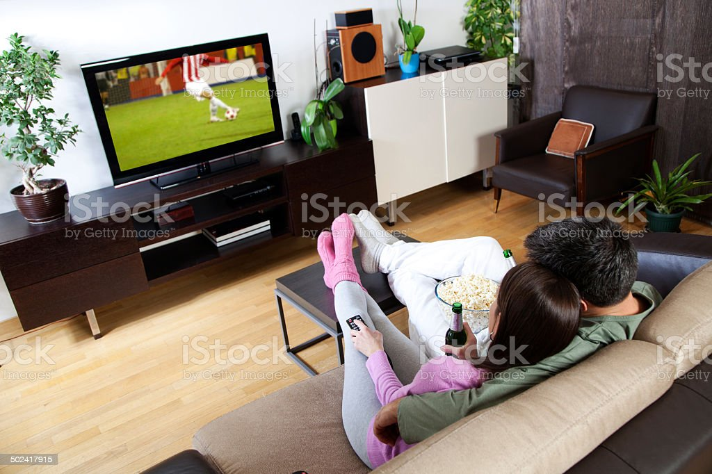 Couple watching sport stock photo