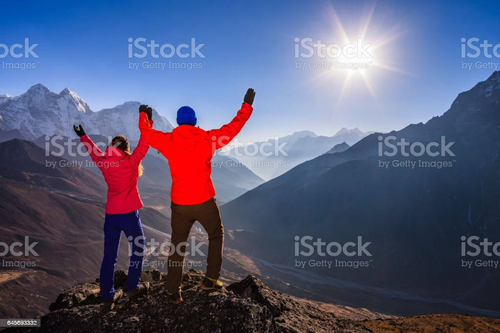 Couple watching sunset in Himalayas, Mount Everest National Park stock photo