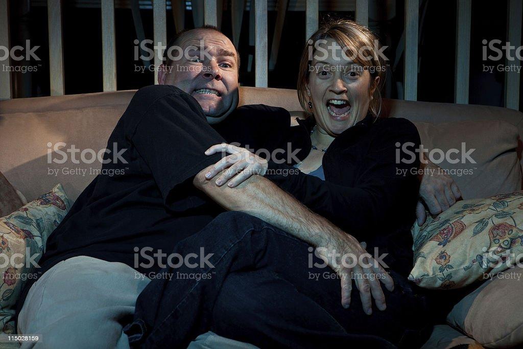 Couple watching tv horror movie royalty-free stock photo