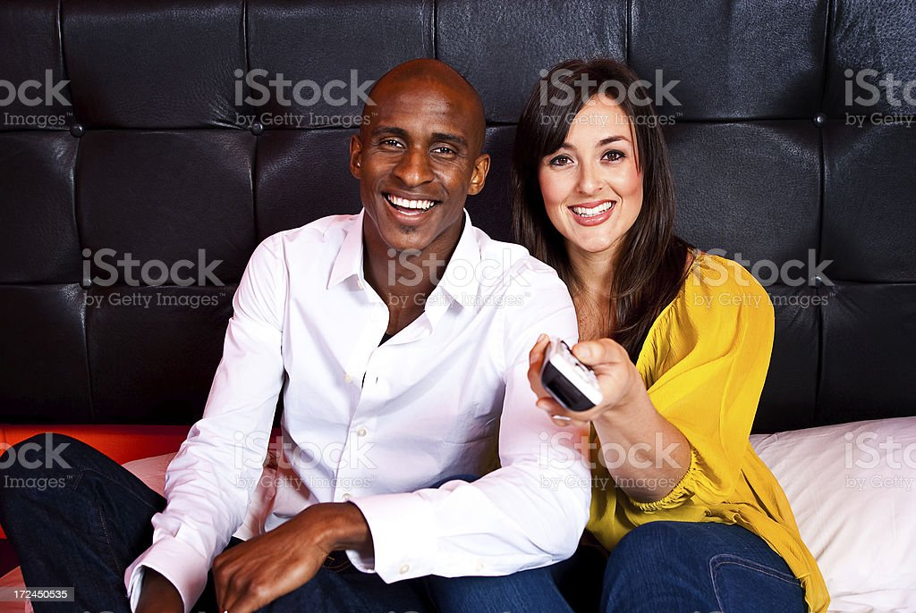 Couple Watching TV in Bed royalty-free stock photo