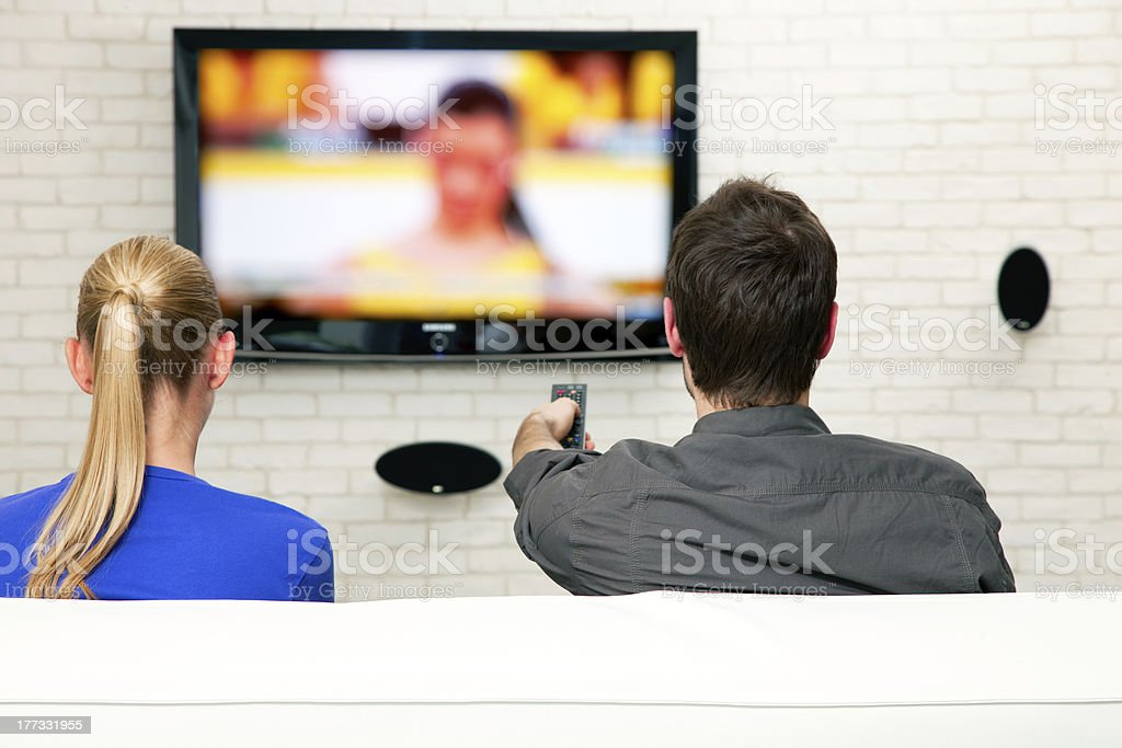 couple watching tv royalty-free stock photo