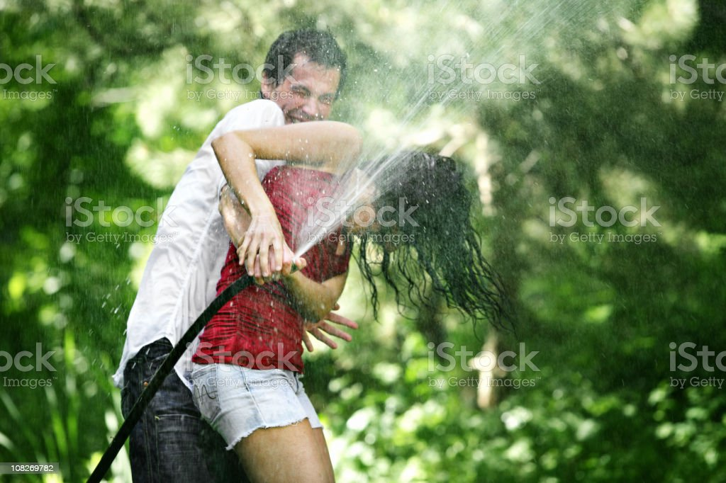 Couple water fighting royalty-free stock photo