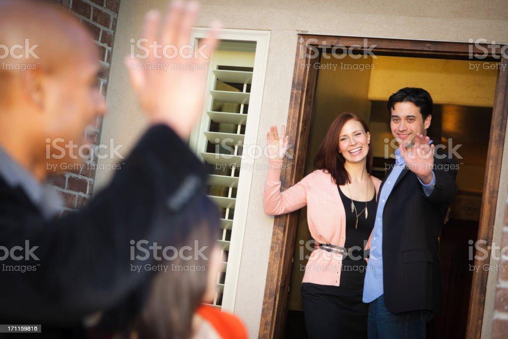 Couple Waving Goodbye stock photo